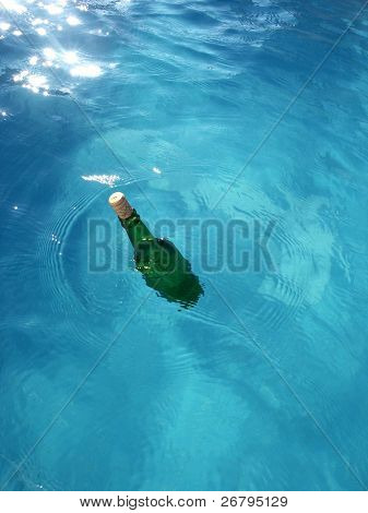 close up shot of a bottle in the water