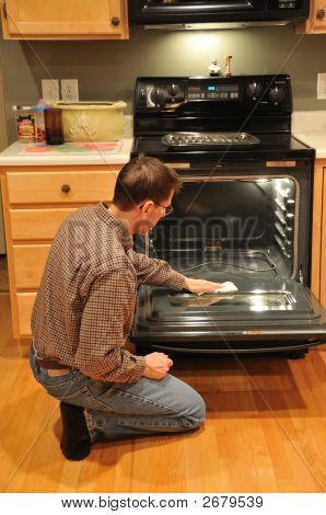 Man Cleaning Oven