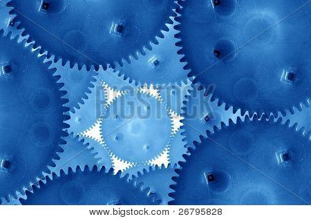 a closeup shot of conceptual blue gears
