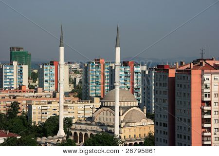 an image of a mosque and buildings