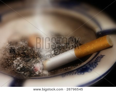 close up shot of cigarette in ashtray