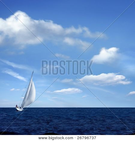 Sailing boat on the sea and blue sky
