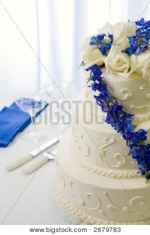 Wedding Cake Decorated With Blue Delphiniums