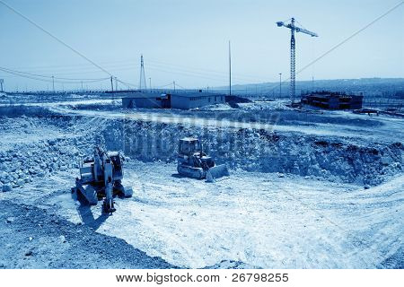 an image of grader at the construction zone