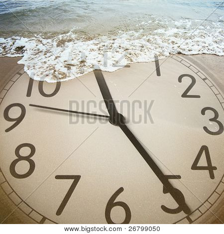 conceptual image of a clock on the beach