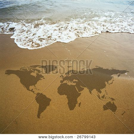 conceptual image of a world map on the beach