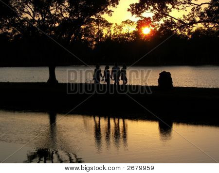 Happy Silhouettes On The Lake