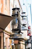 Still Life Of Old Hurricane Lamp On The Street. Reportage Photo. Vintage Lamp. Kerosene Lamp. Old-fa poster