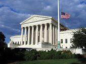 picture of supreme court  - angled view of the Supreme Court courthouse with a cloudy blue sky - JPG
