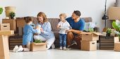 Happy Family Mother Father And Children Move To A New Apartment And Unpack Boxes poster