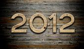 "stock photo of new years celebration  - ""2012"" number on old wood background - JPG"
