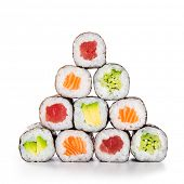 Fresh hosomaki in a pyramid isolated on white background. Sushi roll with salmon, tuna, avocado and  poster