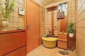 picture of anteroom  - Elegance anteroom interior in warm tones with hallstand - JPG