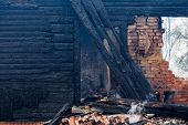 Charred Wooden Parts Of A Burnt House In Latvia poster