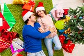 Pregnant wife celevrating christmas with husband poster