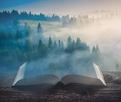 Beautiful Sunrise In A Carpathian Misty Valley On The Pages Of An Open Magical Book. Majestic Landsc poster