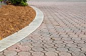 Curved Low Angle Brick Paver Driveway With Mulch poster