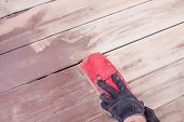 Wood Floor Polishing Maintenance Work By Grinding Machine. Mens Hands With Gloves Make Repairs At Ho poster