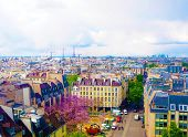 Aerial City View Of Beautiful Buildings On The Horizon In Spring In Paris, View On Eiffel Tower, Bus poster