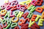 Pile of magnetic letters with the hidden word