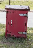 A Close Up Front View Of A Red Old Rusted Post Offcie Post Box Storage Unit poster