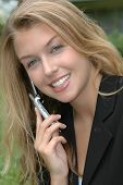 picture of single woman  - business woman using cellphone - JPG
