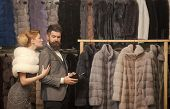 Couple In Love Among Fur Coat, Luxury. Date, Couple, Love, Man And Woman. Woman In Fur Coat With Man poster