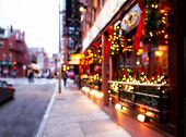 City Street With Christmas Illuminations. Blurred Background. Christmas Lights And Christmas Decorat poster