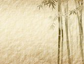 stock photo of orientation  - bamboo on old grunge antique paper texture - JPG