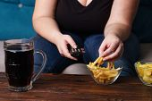 Sedentary Lifestyle, Bad Habits, Food Addiction, Overeating, Eating Disorders. Fat Overweight Woman  poster