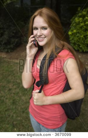 Girl On Phone Wearing Back Pack