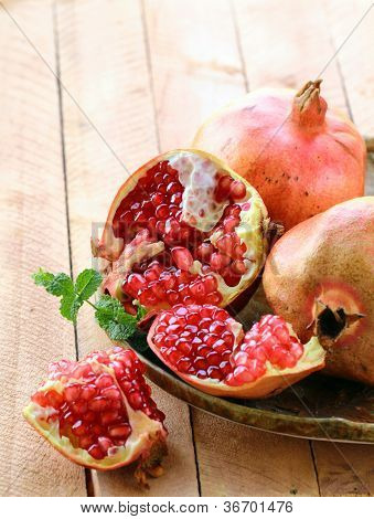 pomegranate ripe fruit on a wooden table