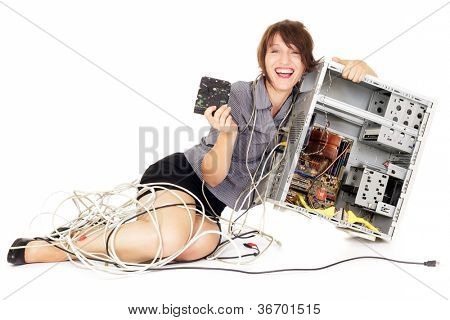 ecstatic woman holding hard disk drive and computer