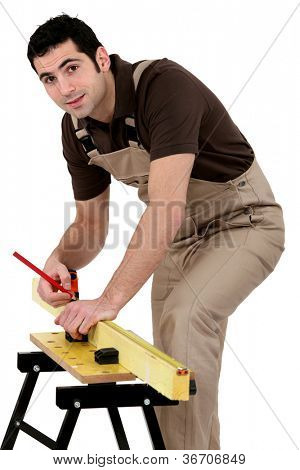 Man measuring wood
