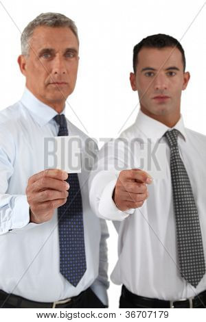 Businessmen showing blank business cards