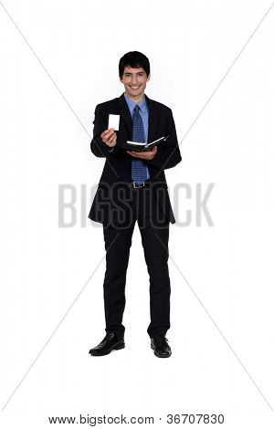 Businessman offering his card from a personal organizer