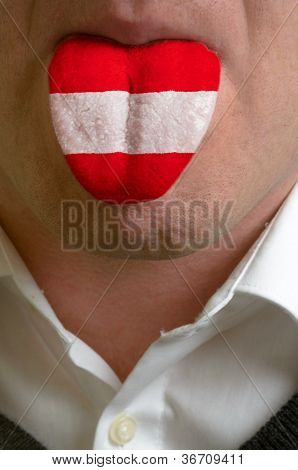 Man Tongue Painted In Austria Flag Symbolizing To Knowledge To Speak Foreign Language
