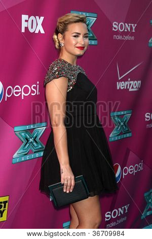 LOS ANGELES - SEP 11:  Demi Lovato arrives at the FOX Season 2 Premiere of X-Factor at Graumans Chinese Theater on September 11, 2012 in Los Angeles, CA