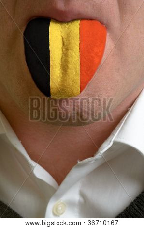 Man Tongue Painted In Belgium Flag Symbolizing To Knowledge To Speak Foreign Language