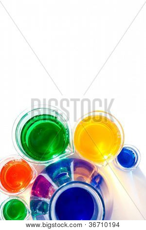 Beakers around an erlenmeyer against a white background