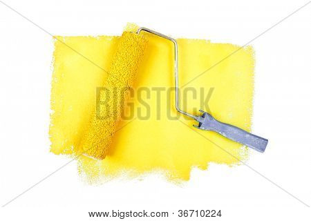 Paint roller on yellow traces against a white background
