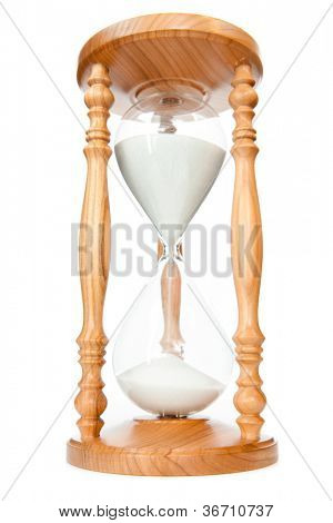Sand flowed of hourglass against a white background