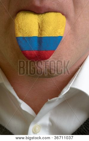 Man Tongue Painted In Colombia Flag Symbolizing To Knowledge To Speak Foreign Language