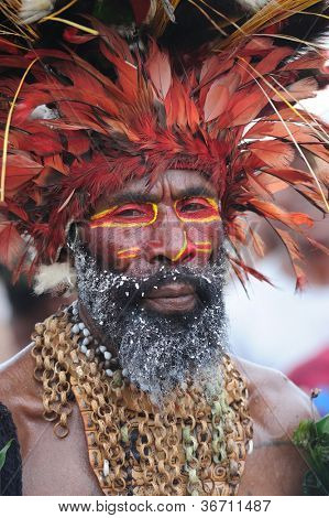 GOROKA, PAPUA, NEW GUINEA - SEPTEMBER 16: colorful portrait of  an aboriginal at Goroka Tribal Festival. Papua New Guinea on September 16, 2011