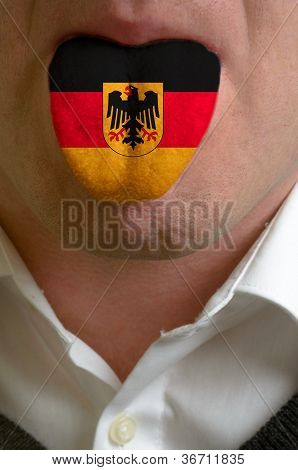 Man Tongue Painted In Germany Flag Symbolizing To Knowledge To Speak Foreign Language