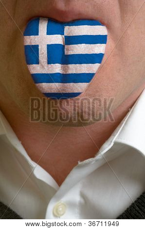 Man Tongue Painted In Greece Flag Symbolizing To Knowledge To Speak Foreign Language