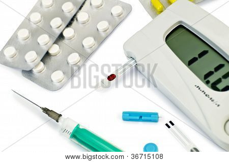 Glucometer With Pills And A Syringe