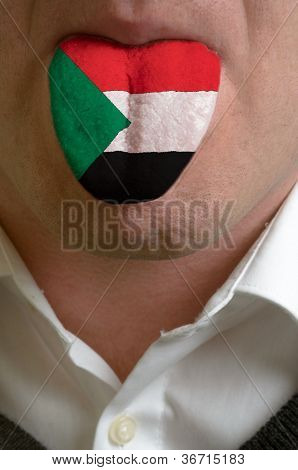 Man Tongue Painted In Sudan Flag Symbolizing To Knowledge To Speak Foreign Language