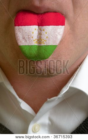 Man Tongue Painted In Tajikistan Flag Symbolizing To Knowledge To Speak Foreign Language