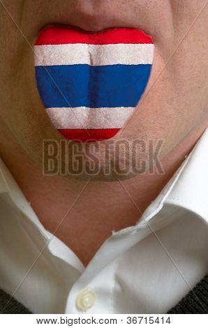 Man Tongue Painted In Thailand Flag Symbolizing To Knowledge To Speak Foreign Language